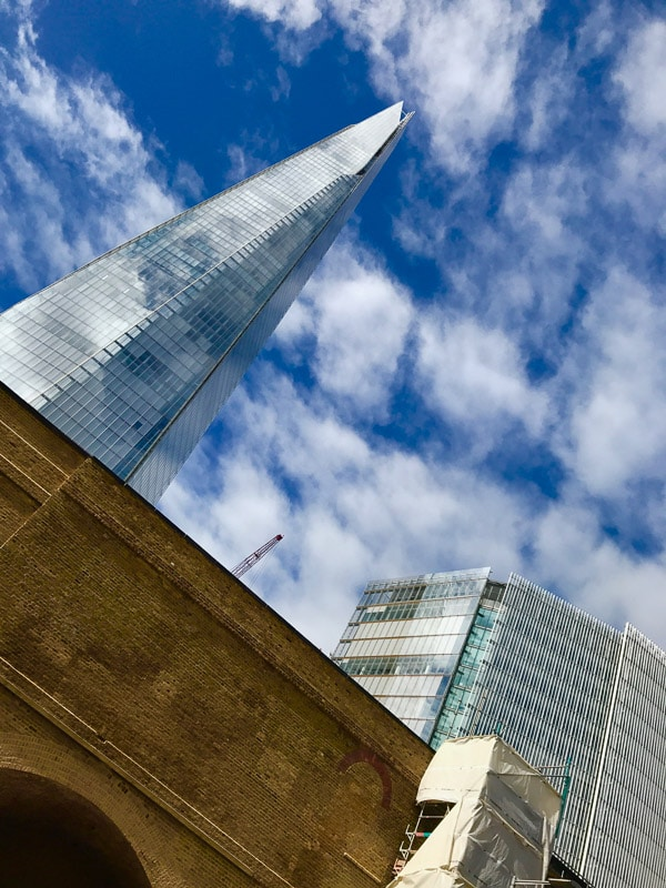 The Shard london against blue sky with clouds