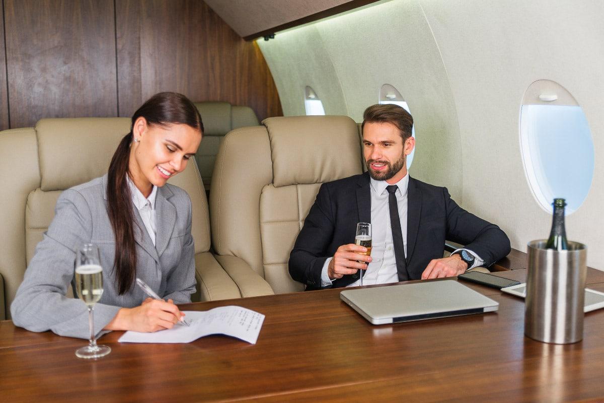 man and woman cheap flights business class