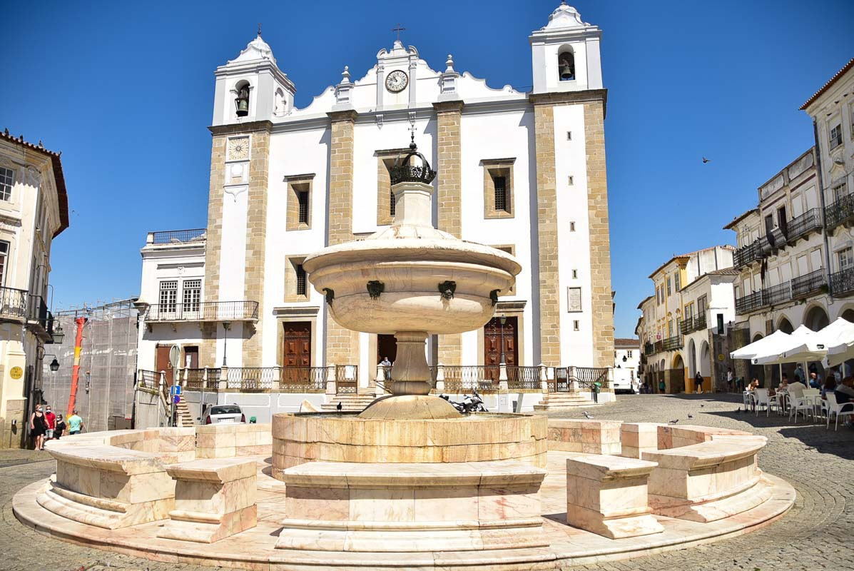 Evora cathedral and fountain